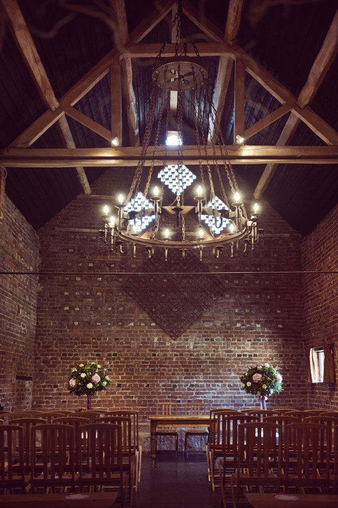 The vaulted Granary Barn at Curradine Barns is at atmospheric setting for a civil ceremony
