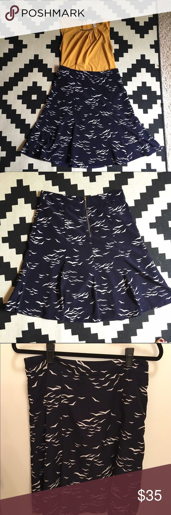 Flirty Banana Republic Navy Bird Skirt This skirt has a cute, flouncy flare at the bottom. It is navy with white birds and a gold zipper in the middle in the back. Looks best worn as a high-waisted skirt with shirt tucked in. Listing is for skirt only. Banana Republic Skirts A-Line or Full