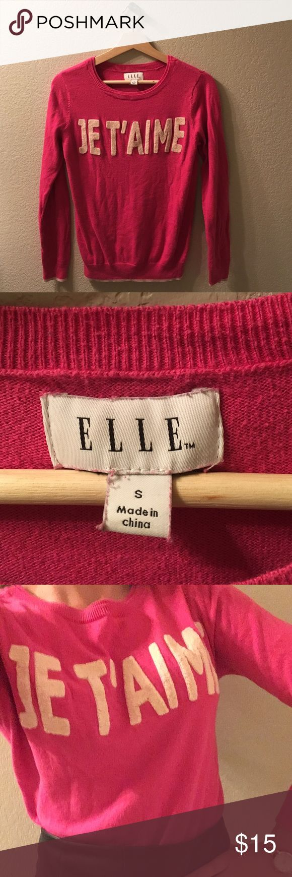 "Hot pink ""JE T'AIME"" sweater. (Jet'aime means I love you in French.) This sweater is especially cute with collared shirts underneath it and with black, high-wasted skirts. Elle  Sweaters Crew & Scoop Necks"