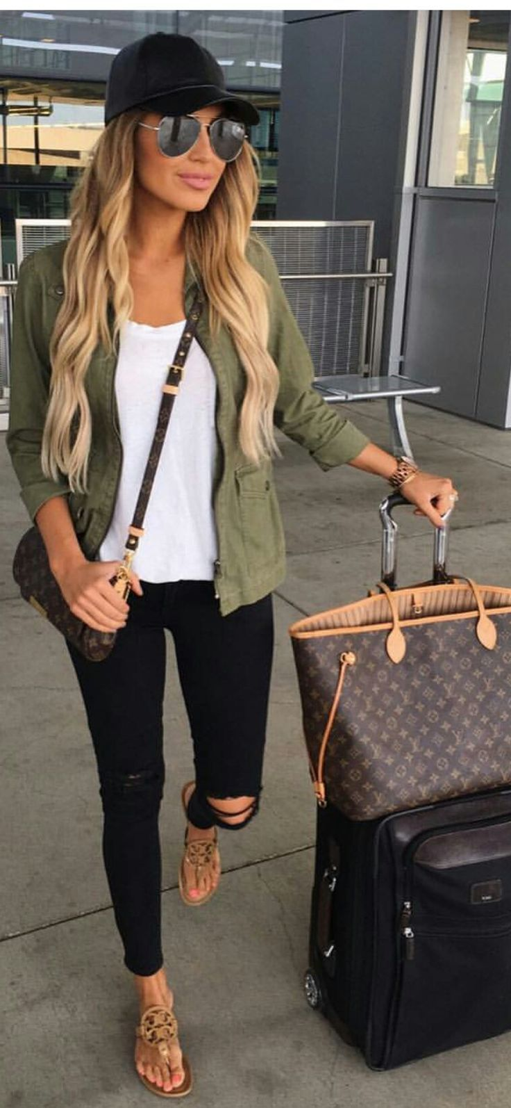 Military green jacket, white t-shirt, black skinny jeans, camel sandals, chocolate crossbody bag