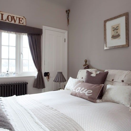 Neutral bedroom with woollen and printed scatter cushions. Elephant's breath No 229 by F&B