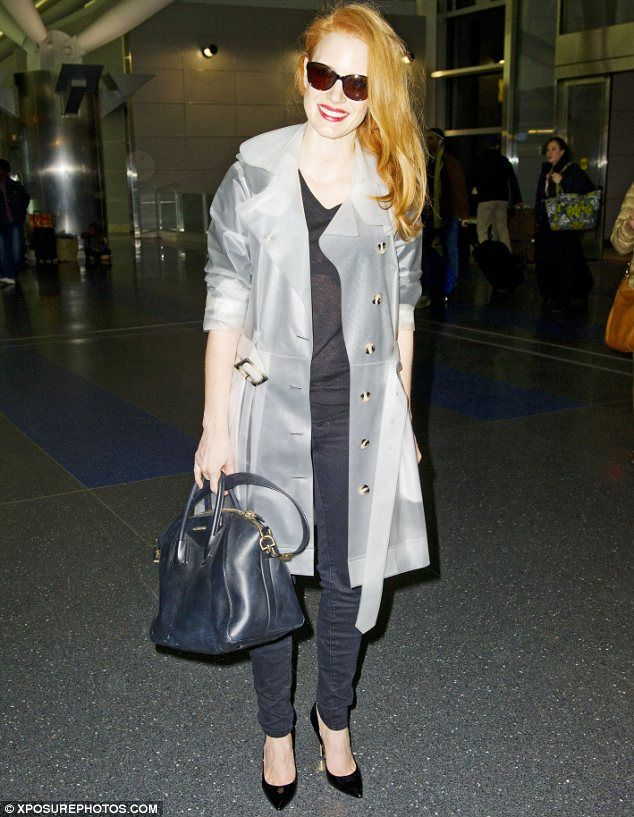 Jessica Chastain in a trench coat by Terra New York.