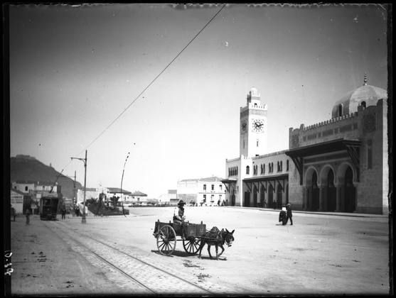 Horse-drawn wagon and rail tracks in the square.  Mosquée de la Pecherie, Algiers Photo from the glass negatives collection of TALIM http://archnet.org/sites/3772/media_contents/105730