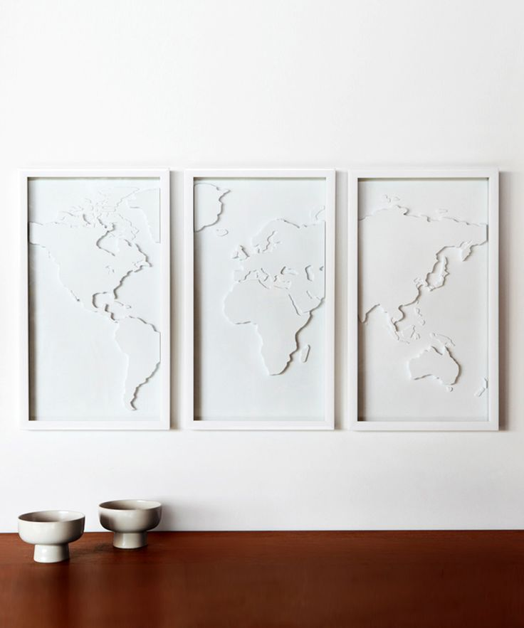 White world map art - It would be fun to have something like this, and then put dots where you've traveled. Maybe even a color for his/hers and then a third color for travels together??