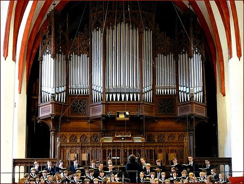 This Is The Older Sauer Pipe Organ Up In The Choir Loft At The Thomaskirche (St Thomas Lutheran Church) In Leipzig, Germany. The Church Has 2 organs. JS Bach Served Here As Music Cantor From 1723 To 1750 AD & Directed The Thomanerchor (The St Thomas Boys Choir Which Began In 1212 AD.)  Amadeus Mozart Played the Organ here & Martin Luther Also preached here.  Shown here is the St Thomas Boys Choir Performing With The Leipzig Gewandhaus Orchestra Performing works By JS Bach.