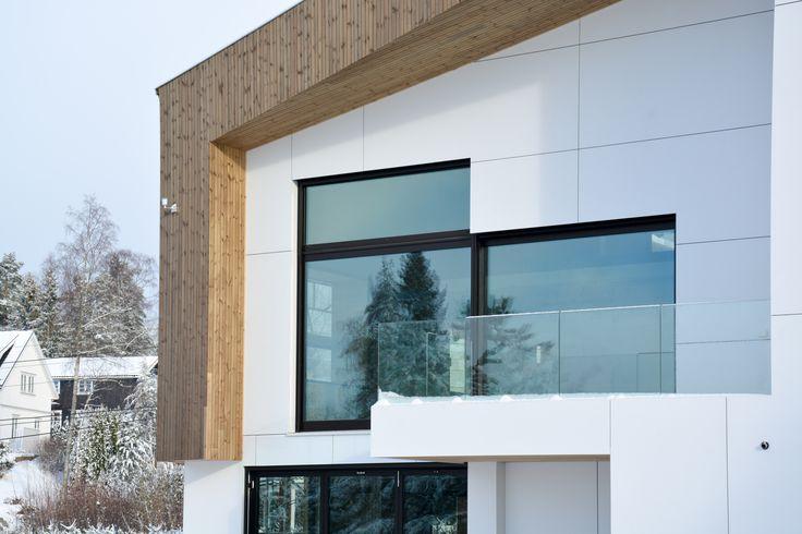 Oslo Norway apartment complex by Various Architects. White and wood facade with playful windows. Modern Architecture, Norwegian Architecture /  Oslo leilighetskompleks av ulike arkitekter. Hvit og tre fasade med lekre vinduer. Moderne arkitektur. Norsk Arkitektur.