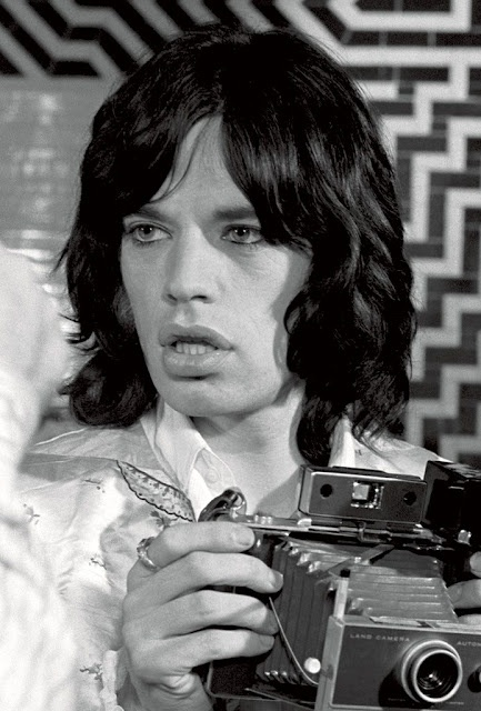 Mick Jagger with a Polaroid ( Image by Baron Wolman)