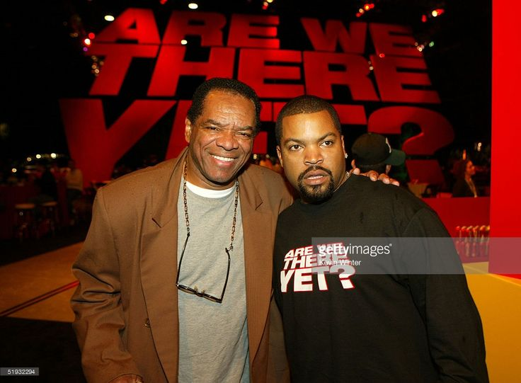 Actors John Witherspoon and Ice Cube pose at the after party of the premiere of 'Are We There Yet' at Barker Hanger on January 9, 2005 in Santa Monica, California.