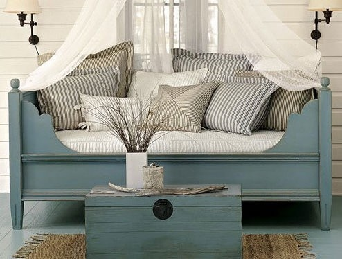 Todder bed turned Porch seating. Maybe use crib mattress?
