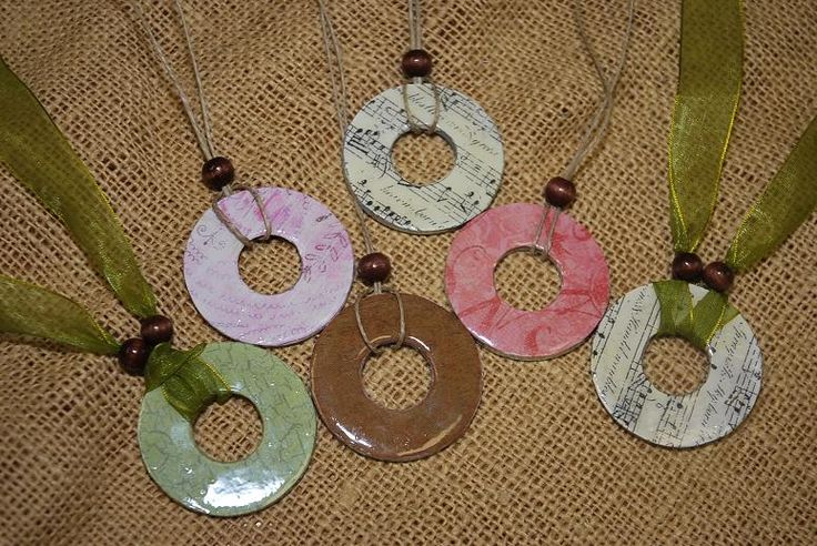 Beautifl necklaces made from ordinary washers and scrapbook paper. I sense a trip to the hardware store soon...