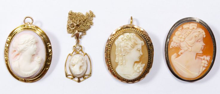 Lot 274: 14k Gold, 10k Gold and Sterling Silver Framed Carved Shell Cameo Assortment; 14k gold cameo pendant on a 10k gold necklace, 10k cameo by George L. Paine and Italian sterling silver cameo; all having stamped purity marks except pendant; together with a gold filled cameo