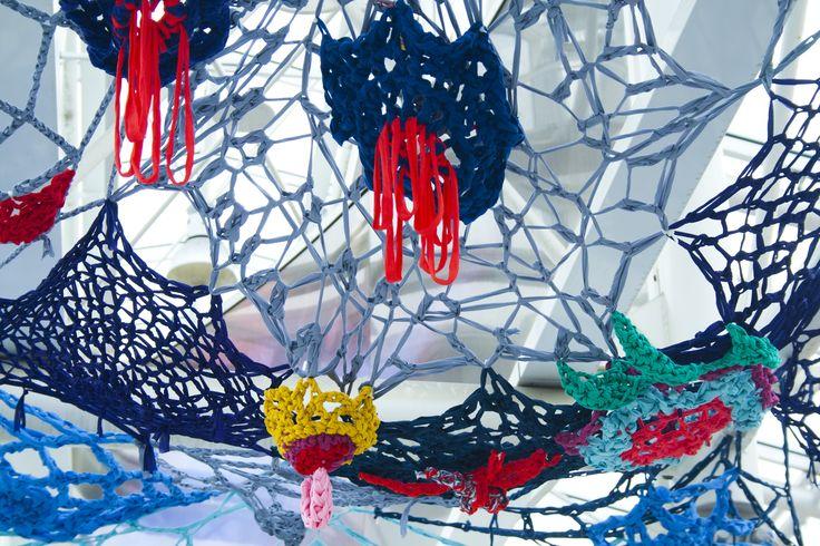 Flower yarnbombing for textile graffiti lovers <3