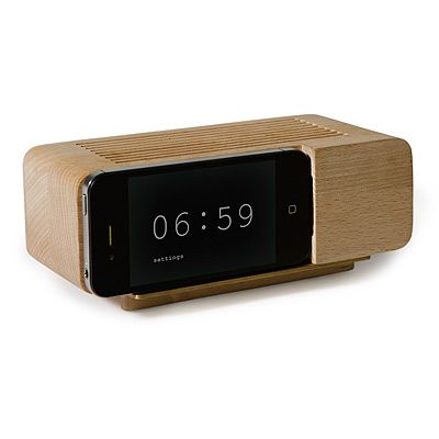 $39.50 that is a radio/dock charger that turns your iphone into an adorable retro alarm clock. dreamy. at uncommon goods.