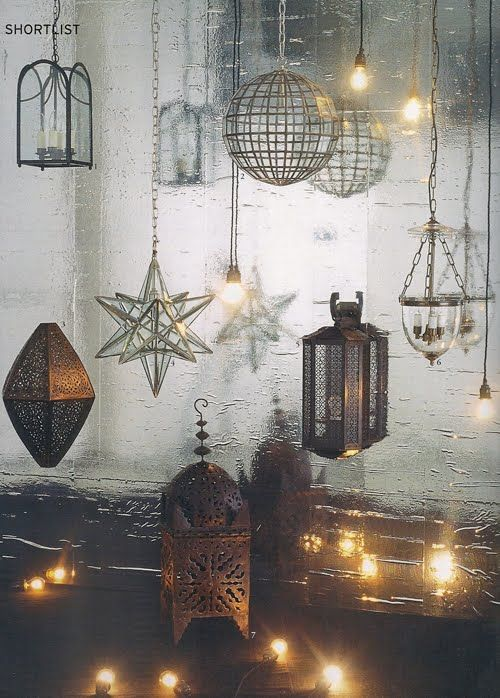Charles Edwards lanterns (from http://charlesedwardslighting.blogspot.com/2011/02/world-of-interiors-porch-lantern.html)