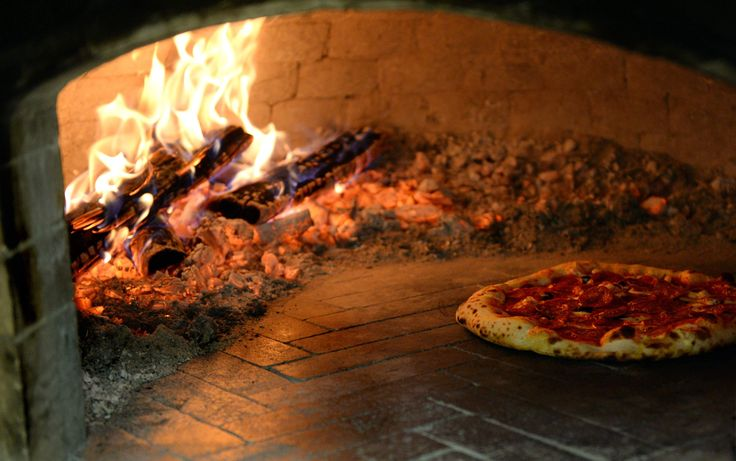 A pepperoni pizza bakes in the wood fired oven for only about two minutes before it's ready to serve at Clay County's Pizzas & Cream.