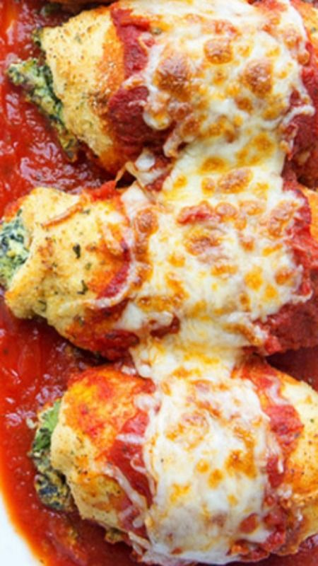Easy Stuffed Rolled Chicken Recipe ~ fresh spinach, some bacon, cream cheese, a little salt and Parmesan, rolled into flattened chicken, breaded and tossed in the oven. Topped with some marinara and sprinkled with mozzarella cheese