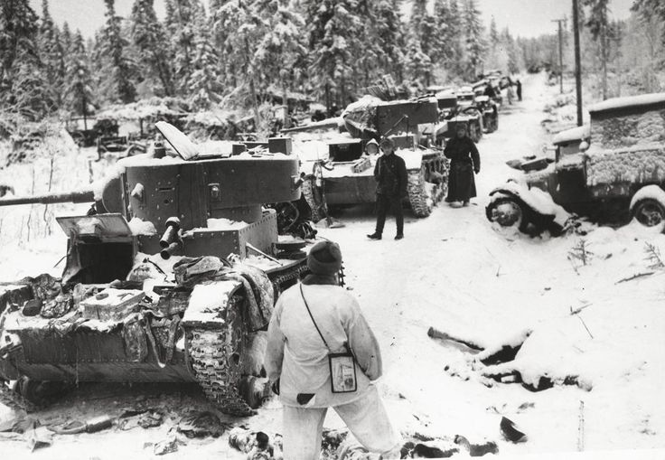 Spoils of war -- captured Soviet tanks and cars, along a road in a snow covered forest on January 17, 1940. Finnish troops had just overpowered an entire Soviet division.