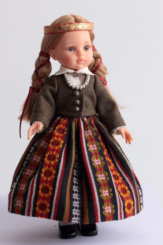 Latvian folk costume dolls from various regions.