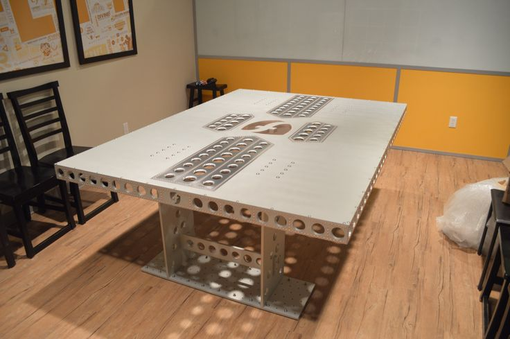 Truly industrial table. Machined structure, stainless steel hardware.