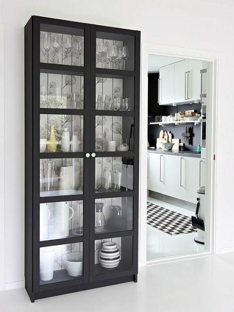 The Ikea Billy bookcase with doors. Great for small apartment living and versitile