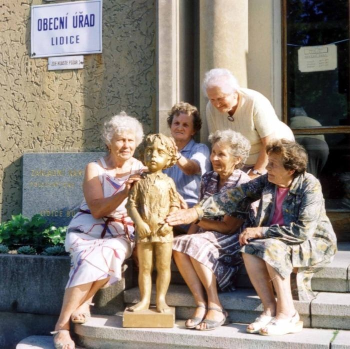 Lidice moms with one of the statues of monument to 82 murdered children of Lidice (1998).