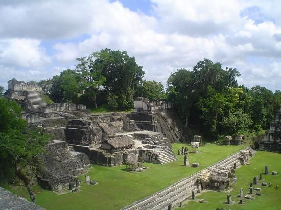 """Tikal National Park - Getting Around the City  """"...Tikal National Park occupies an area of 125,000 acres. The ruins occupy six square miles. An excellent trail system leads you to the major excavations from the lodge and restaurant area. You enter the site on the Mendez Causeway which leads to the Great Plaza. This is the center of the restoration project and contains Temple I, Temple II, the Central and North Acropolis..."""""""