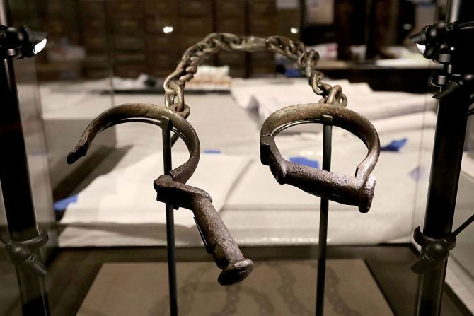 A pair of slave shackles are on display in the Slavery and Freedom Gallery in the Smithsonian's National Museum of African American History and Culture on the National Mall in Washington, D.C., during the press preview Sept. 14, 2016.