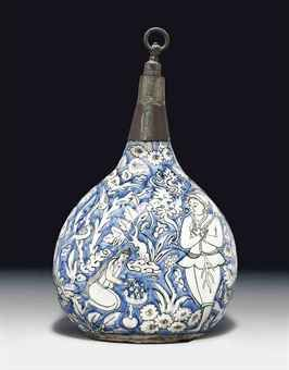 A SAFAVID MOULDED BLUE & WHITE POTTERY BOTTLE  IRAN, MID 17TH CENTURY  With rounded body flattened on each side, rising to a tubular neck, white body moulded & decorated in reserve against the blue ground with a man shooting at a deer, as a crane flees in fright on one side, other side with the man returning to his diminutive woman with the deer on his shoulders, amongst a proliferation of trees, flowering shrubs & birds, neck now missing and replaced with North European iron & pewter 13…