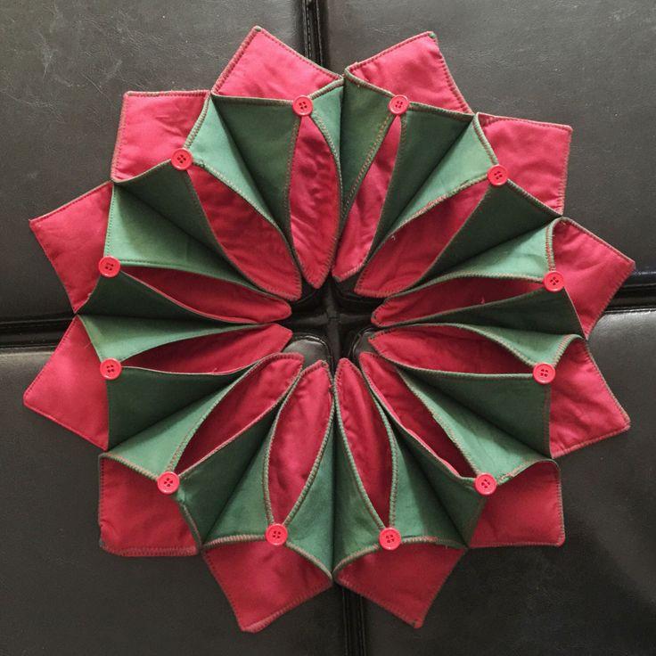 Poinsettia Folded Fabric Wreath by K9Creative on Etsy https://www.etsy.com/listing/491105453/poinsettia-folded-fabric-wreath