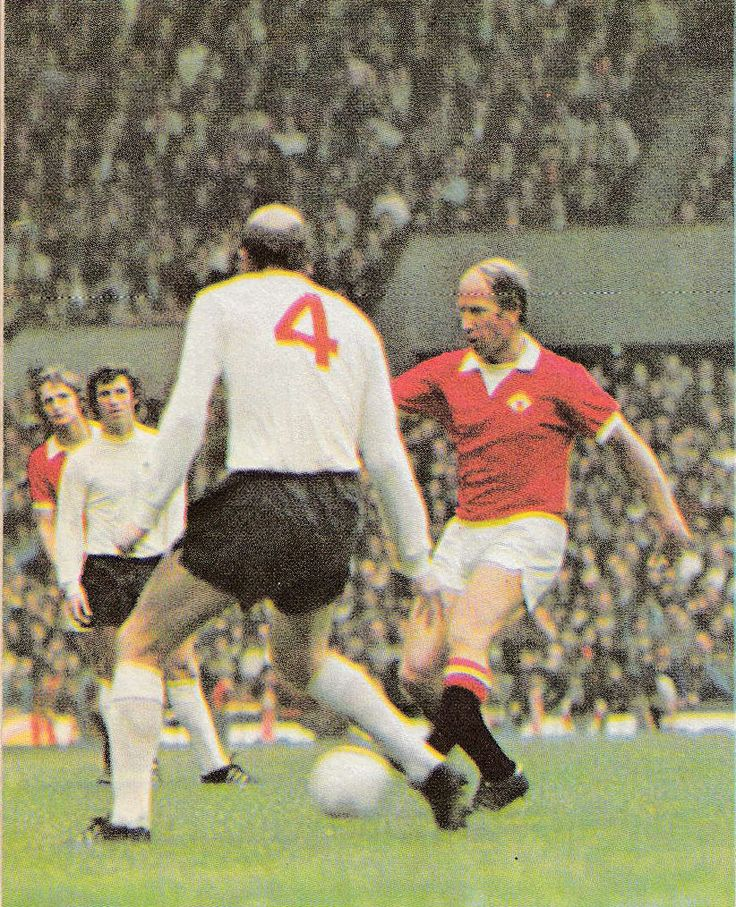 16th October 1971. Manchester United and England's Bobby Charlton confronted by Derby County utility player Terry Hennessy, at Old Trafford.