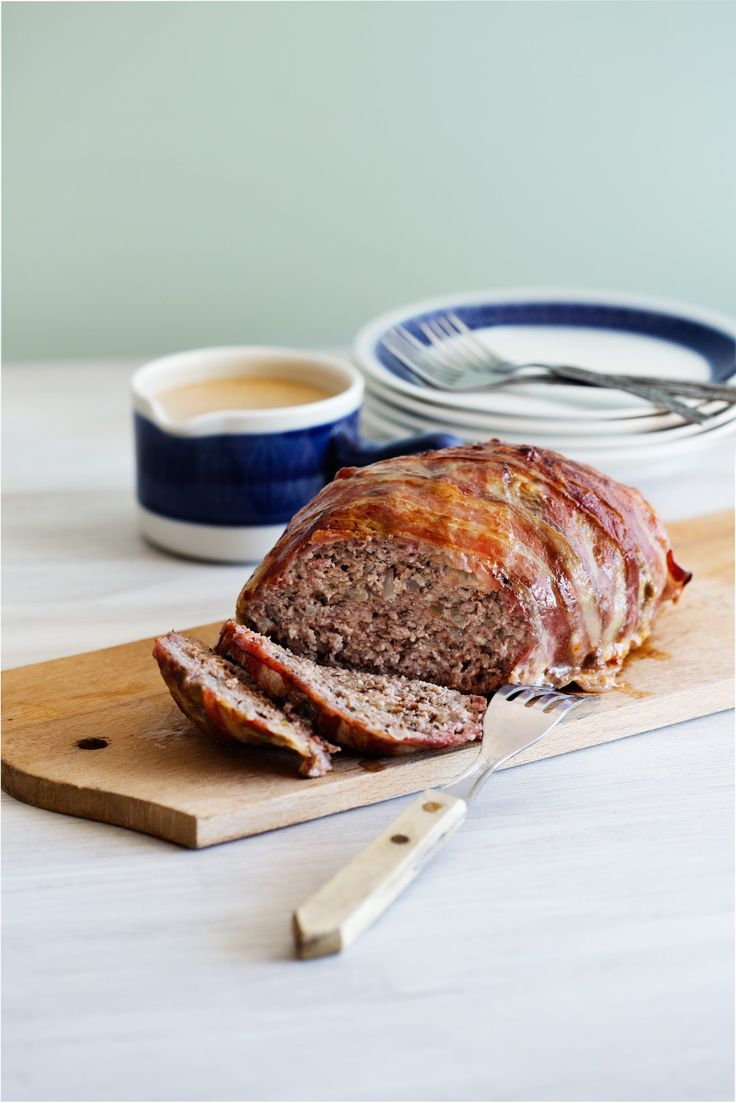 What's more comforting and satisfying than meatloaf? How about meatloaf wrapped in bacon, seasoned perfectly, and dowsed with a rich, creamy gravy? Yep. I think that'll do. That'll do just fine.