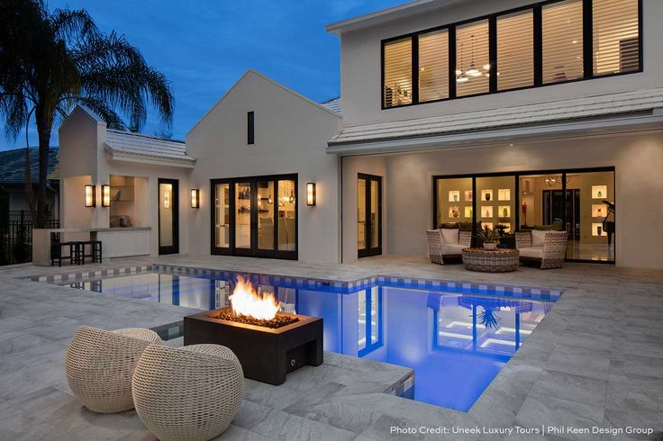 Lyra Fire Bowl - modern linear design. Outdoor living space with pool and fire feature.
