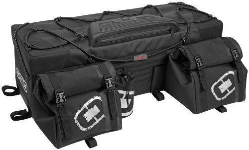 OGIO ATV Honcho Rear Bag – Stealth 119003.36  Rigid construction holds shape when empty. Zipper-less main compartment opening for ease of access. Convenient, quick access buckles. Multiple internal compartment storage with collapsible divider partition. Dust Gasket seal protects inside contents from rain, dust, mud and snow. Quick access molded top pocket with weatherproof zipper. External removable insulated water bottle holder. Adjustable/removable cinch strap system for extra gear..
