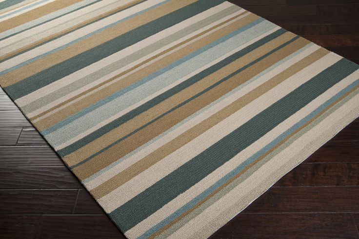 Indoor outdoor area rug with stripes inspired by the colors found in  windswept sea grass covered sand dunes.