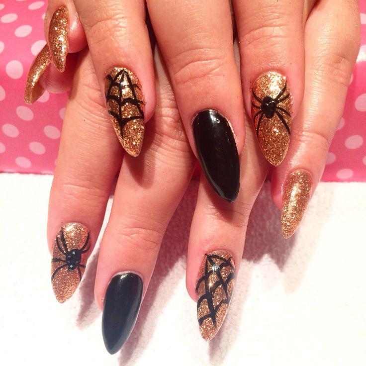 Rose Gold Glitter & Black Halloween Stiletto nails with Swarovski crystals…