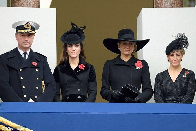 The first time Kate stepped out in the coat in 2015, she added a netted fascinator  as she joined (l-r)Tim Lawrence,Queen Maxima of the Netherlands and Sophie, Countess of Wessex