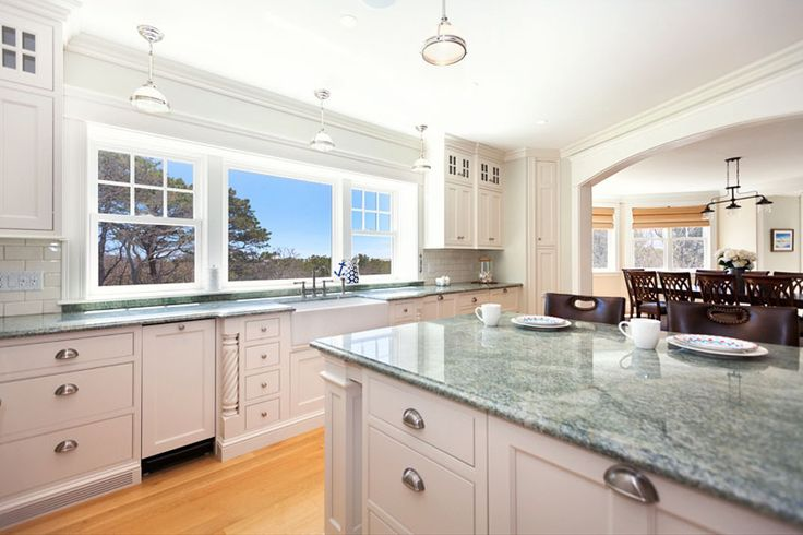 Traditional kitchen with white cabinets and tropical green granite counters