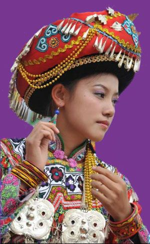 China | Yi people have a tradition of wearing colorful headgear | A Yi woman's headgear reveals her age and social identity |