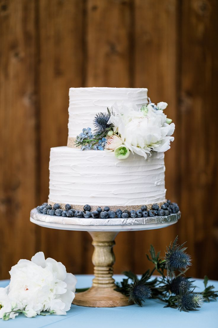 blueberry and gold wedding cake