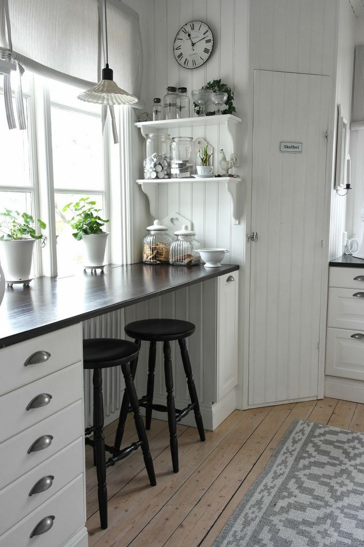 Kitchen bench with cute stools :) Whole thing is light and bright.