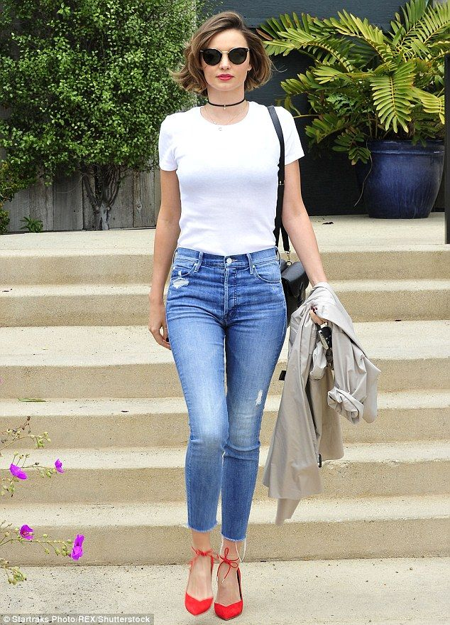 Heating it up: Miranda Kerr added a pop of colour to her simple jeans and T-shirt ensemble with bright red high heeled shoes when she was spotted out in Malibu on Sunday