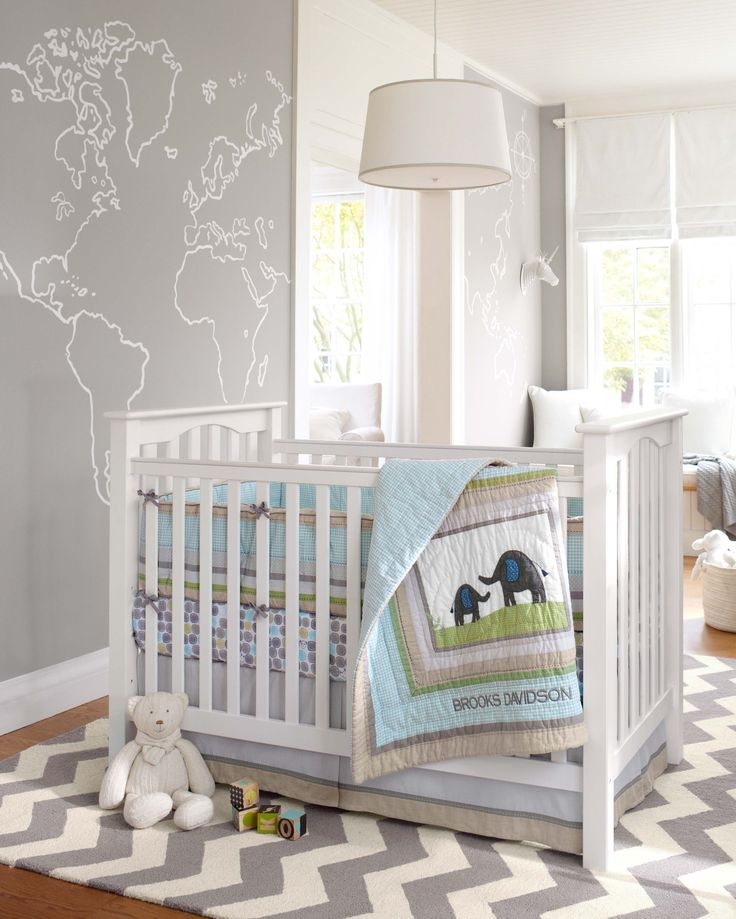 The gender-neutral Brooks nursery collection is a sweet take on the safari theme. Rather than the traditional khaki and green, this pastel blue and green set looks soft in the modern room, while the map-adorned wall is one that kids could grow into for years to come.