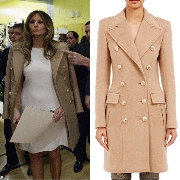 Melania voted  wearing a Balmain coat . . .
