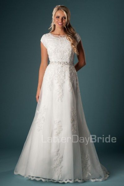 Abelardo | This A-line silhouette is adorned with lovely lace appliques and trim. The soft lace illusion boat neckline adds an interesting touch to this modest bridal gown.    Modest Wedding Dress | Modest Wedding Gown | LatterDayBride  | LDS | SLC | UT | Salt Lake City | Utah | Worldwide Shipping |
