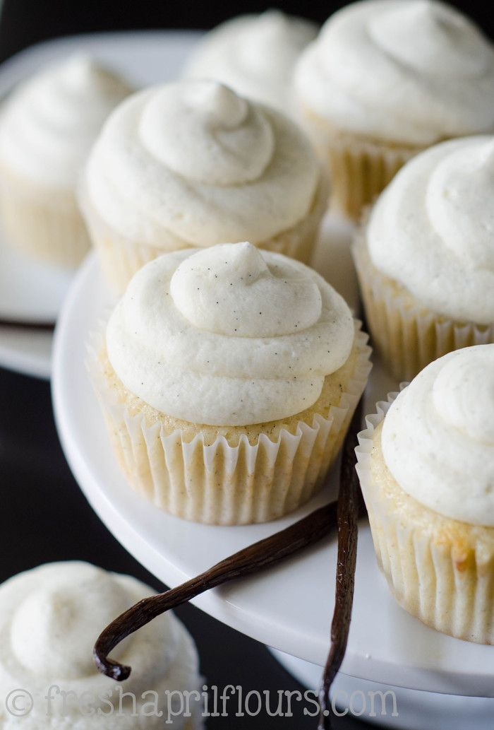 Vanilla Bean Cupcakes ! A moist and tender vanilla cupcake made extra flavorful with vanilla bean infused cream then Piled High With the most Amazing  with Buttercream Frosting !