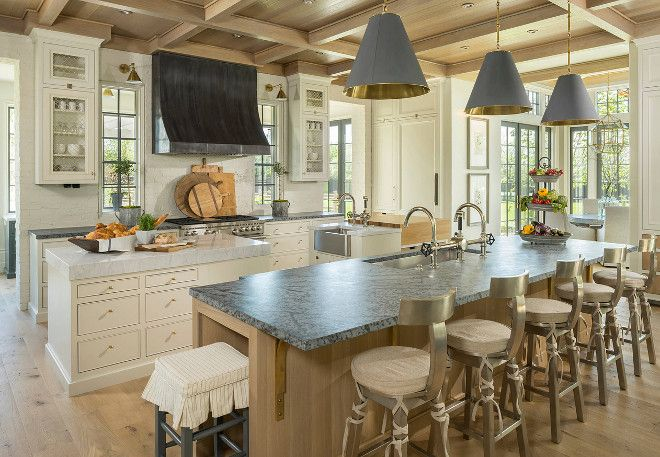 Kitchen with three islands. Kitchen with main island and two prep islands…