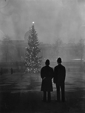 London, Trafalgar Square, 1st December 1948 • Two policemen regard London's 64ft Christmas tree, a gift from Norway, illuminated in Trafalgar Square, in front of the National Gallery. The tradition carries on every year