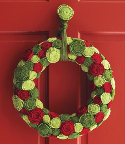Understated felt gets a royal transformation when it's spiraled and coiled into a stunning array of rosettes. Follow this color palette, or create your own, playing with various shades of green and red. Click here for how-to instructions.  - WomansDay.com