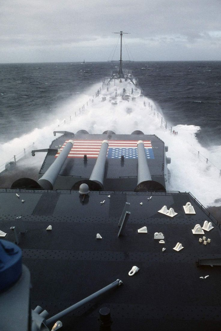 Battleship USS Iowa (BB-61) taking it wet over the bow, 1980s.