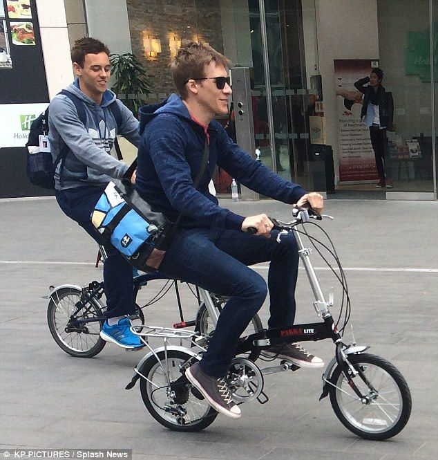 Riding off into the distance: Tom Daley and boyfriend Dustin Lance Black go for a Brompton bike ride